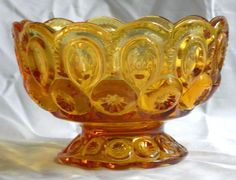 L E Smith Amber Glass Moon & Star Design lidded candy dish. Glass is pressed…
