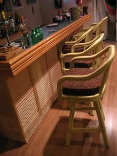 "Island Bar. I built this using unfinished louvre doors, the frame of the bar is made up of purchased organizers that contained laminated shelving and  a shoe rack (good wine storage) -I had to cut the bottoms down. The top is a very cool linoleum on a 1/2"" finished plywood (for flatness). The railing is banister on top, and 4"" moulding - the same moulding is used on the bottom of the Louvres. This bar is 11' long and extremely functional. Lights are hidden under the top rail moulding. Have…"