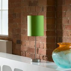 Green fabric shade table/desk lamp/light bedside modern new 857.  A truly stunning item featuring polished chrome stem and base with beautiful high quality cotton lime green shade.  Made by Europe's top lighting manufacturer, please do not confuse with cheap Asian copies.  Available in a whole range of colours.  Matching standard lamps also available.
