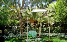 Natural #birch #chuppah draped with white flowers -  #hydrangeas, #roses and #orchids