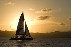 Sunset sail with St Thomas is the background.