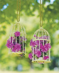 Michaels.com Wedding Department: Birdcage Lanterns Set the tone of your special day with these whimsical birdcage lanterns. Use as a tabletop decoration or hang with colorful ribbon or twine. Add flowers to bring color to eye level.