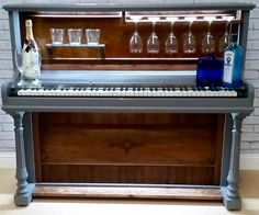 A stunning bespoke piano bar. Some of the original panels have been utilised in the finished item. A toughened glass shelf has been fitted over the keys to maintain the authenticity of it
