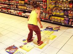Nesquik does POS advertising like no other by creating a sub-environment for kids to play in an environment that is usually for adults.