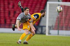 Captain David McGregor making sure he gets the ball away