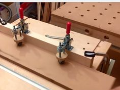 This jig, with ii's sllightly canted in wheels, pulls the workpiece into the fence like a feather board you don't have to set.