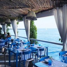 Eat: Ristorante il Riccio - Via Gradola, 4, 80071, Anacapri Blue wooden tables and red coral are the decorative trademarks of this Michelin-starred restaurant at the Capri Palace Hotel. You can spend the day at the hotel's Beach Club, then watch the sunset while eating the most beautifully presented dinner of seafood and pasta. It's like Capri's version of Club 55 in St.-Tropez. Just don't leave without checking out the dessert room.