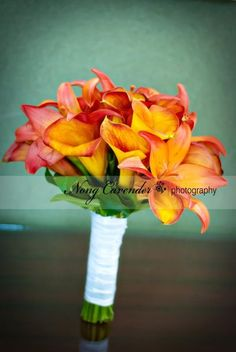 orange calla lily and orange tiger lily make up this bridal bouquet.  I don't like the white ribbon though...