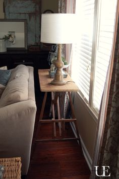 DIY Sofa table.  Made from an old Ironing board at UnexpectedElegance.com