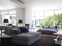 FABULOUS studio apartment. Love the light, the fireplace and that view!