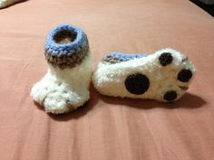 """Dog paw booties. Pattern on ravelry.com """"Lion paws & Mitts"""" the author name is Carolyn VanOstran"""