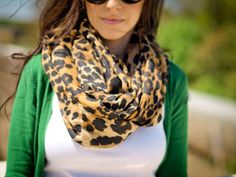 Leopard scarf with green sweater. I love that leopard goes withliterally anything.