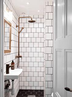 Shower with White Square Tile Walls Black Hexagon Tile Floor