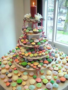 Cupcake tower....this is probably what ours would end up looking like, because we would need so many.  Hmmmm....