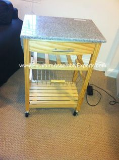 Granite top kitchen cart assembled in Washington DC by Furniture Assembly Experts Company