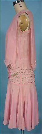 """1925 Pink Chiffon and Beaded Flapper Dress with Rhinestones! I wish I could tell you that this dress is in perfect condition, but there are a few issues to mention. Nothing of huge importance, but still, I like to sell items as perfect as possible. I've owned this dress for over 15 years (that will give you some idea of how much I love it!), but it's time to give her a new home. She's been asking me for years... :) So... She's a light pink silk chiffon edged in small rhinestones at the """"..."""