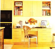nice desk area in the kitchen, reminds me of my home!
