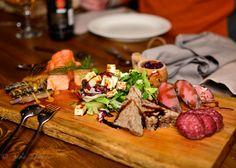 Traditional Lappish food, reindeer steak and sausages, Lappish cheese, fresh and smoked fish