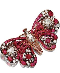 ANTIQUE GEM-SET BUTTERFLY BROOCHES The set on the body and wings with cushion-shaped, old-mine and rose-cut diamonds together weighing approximately 5.00 carats, further accented with cushion-shaped and calibré-cut rubies, mounted in silver and gold, circa 1860.