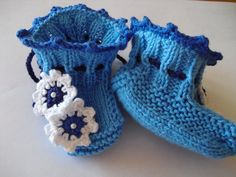 Knitting Baby Booties Shoes With Cute Flower. $11.95, via Etsy.