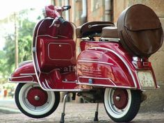 Lovely plum red scooter.
