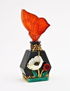 1920s Czech perfume bottle, black crystal, figural red crystal stopper, jeweled gilt metal mount marked Czechoslovakia. 5 in.
