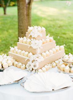 Cupcake tower using burlap and paper flowers...