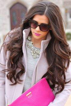 Grey shirt, neon pink tote bag and diamonds statement necklace.