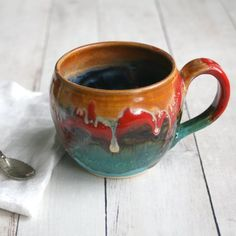 This beautiful mug was hand thrown and trimmed on my pottery wheel using a white stoneware clay. It was bisque fired and glazed with 6 different cheerful glazes and high fired in my electric kiln....