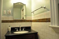 subway tile bathroom with art tile border