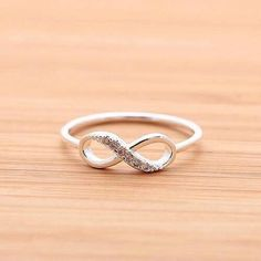 INFINITY ring with crystals,in silver (plated, 925 sterling) Fancy Jewellery, Stylish Jewelry, Cute Jewelry, Gold Jewelry, Jewelry Rings, Jewellery Shops, Tiffany Jewelry, Gold Ring Designs, Ring Design In Gold