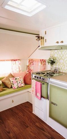 Camper Glam.   Like how they have kept the original avocado green appliances and made them work in the new decor!