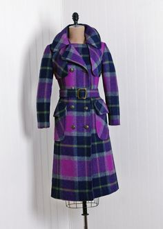 Couture Coat, Mackintosh, New York: 1960's, fully lined plaid wool, wide-collar double-breasted military capelet-accented bodice, matching belt, side pockets.