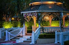 Romantic nighttime ceremony at Disneyland's Rose Court Garden #wedding #ceremony