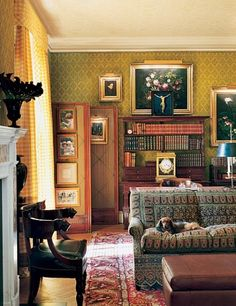 """""""The mixture of textures and fabrics, silk and cotton, makes the library inviting,"""" notes Marino, who designed the hand-printed wallcovering. The collection of Scandinavian paintings includes 19th-century floral still lifes by Danish artist Johan-Laurents Jensen."""
