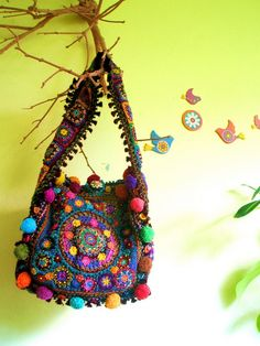 granny square bag with pompoms. love it!.