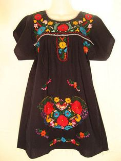 mexican folk dress... (I hate these colors)  I remember wearing these - my favorite was black with turquoise, green and white embroidery on it... loved that dress, wish I could find some more of them today... *~<3*Jo*<3~*