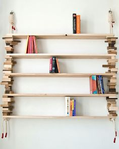 Another twist on a classic bookshelf. We've done this before but it didn't have rope running through it and it wasn't suspended.