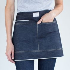 305 waist apron is thoughtfully designed for those who do not want or need a full apron. Multiple pockets for the bar, restaurant, coffee shop, grill, or kitchen. Hand wash in cold water to av Diy Jeans, Waist Apron, Unique Handbags, Leather Apron, Denim Ideas, Linen Apron, Sewing Aprons, Half Apron, Apron Designs