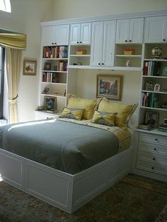 White Custom Platform Bed with Built-In Wall Unit   California Closets   I like the idea of shelves under the top cabinet bridge, and perhaps over top of the whole she-bang.