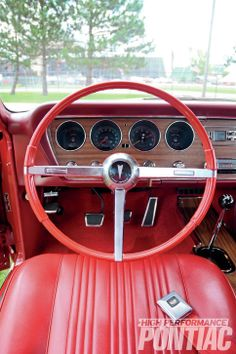 1967 Pontiac GTO-powered by either a 400 or engines; carb moving this 4800 pound musclecar! Interior-Red Means Go Steering Wheel Photo 9 1967 Gto, 67 Pontiac Gto, Amc Javelin, Race Engines, Mustang Cars, Old Cars, Mopar, Muscle Cars, Interiors