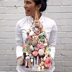 There's me showing off our all new Horn of the Unicorn Croquembouche Cake #weddingcake