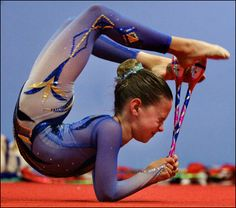 A rhythmic gymnast worked on her club routine as she trained for the Rhythmic Gymnastics Junior Olympic Championships at the New England Sports Academy in Westwood on Thursday, May 24.