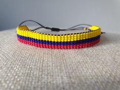 """Handgeweven kralenarmbandje """"Colombiaanse vlag"""" / Loom beaded bracelet """"Colombian flag"""" / Kralenarmbandje met waxkoord Bohemian Bracelets, Bohemian Jewelry, Beaded Bracelets, Colombian Flag, Boho Gypsy, Loom, Seed Beads, Handmade Jewelry, Etsy"""