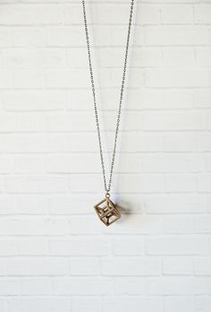 """4D creation, beautiful and simple tesseract necklace made of stainless steel on a matching chain. Cube is approximately 1"""" in size and chain is approximately 24"""" long."""