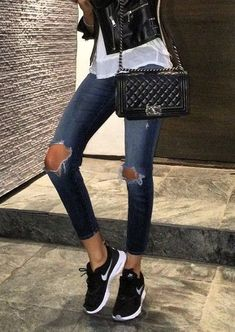 sporty outfit with nike sneackers ripped jeans and chanel bag