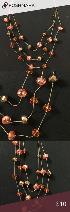 Three layers necklace. Very pretty necklace. Orange and brownish golden. Always get complements. Jewelry Necklaces