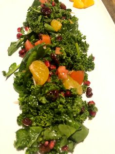 This salad is full of alkaline vegetables and delivious flavors of massaged fresh kale leaves with juicy bursts of pomegranate seeds, orange segments and dried cranberries. Easy to make and a great centerpiece for a family meal or gathering. Large Salad Bowl, Salad Bowls, Thanksgiving Recipes, Holiday Recipes, Massaged Kale, Kale And Spinach, Spinach Leaves, Pomegranate Seeds, Spinach Salad