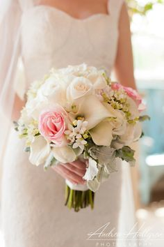 beautiful bridal bouquet with roses and calla lilies