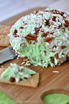 Sweet Pistachio Cheeseball: made with pistachio pudding, coconut, and pecans.